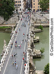 People on the bridge of Sant'Angelo in Rome, Italy