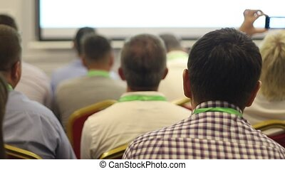 People on the business conference - rear view, close up