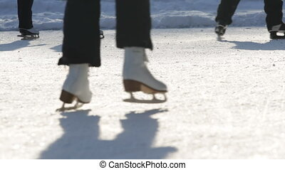 People on the ice skates