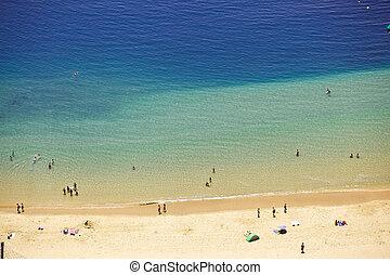 people on the ocean beach