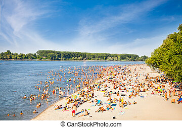 People on the public beach Oficirac on Danube river, Novi...