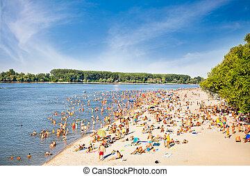 People on the public beach Oficirac on Danube river, Novi...