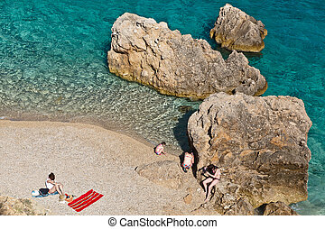 People on the Rocky Beach in Croatia
