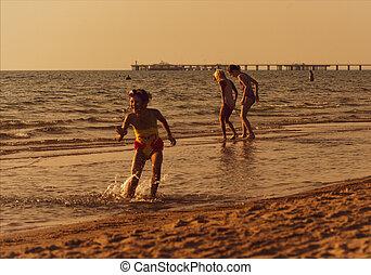 Anapa, Russia - september 25, 2020: child girls frolic on sea sandy beach
