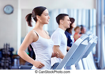 People on treadmills - Attractive people on the treadmill