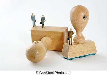 People on wooden rubber stamps on white background