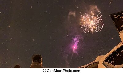 People outside watching the New Year fireworks