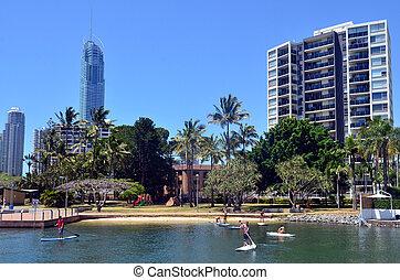 People paddle board in Gold Coast Queensland Australia -...
