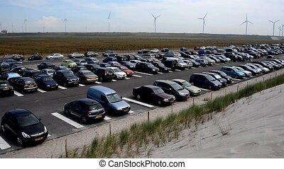 people parking near the beach