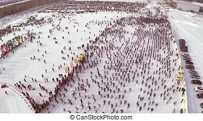 People participating in the mass ski race Ski Track of Russia during the competition. competition skiing, the crowd. a large number of people taking part in the competitions on the slopes