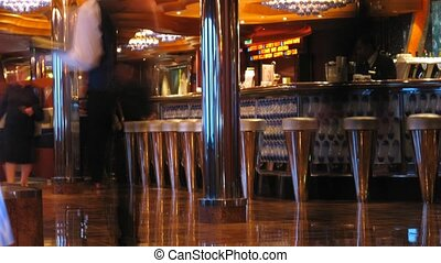 People pass by bar rack on board of cruise liner