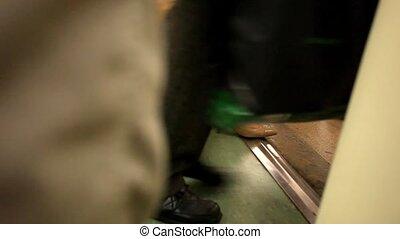 People pass through doors at the metro. HD. 1920x1080