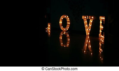 People passing light words of love on glossy floor