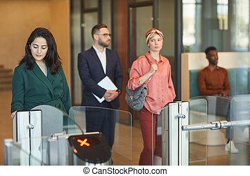 People Passing Turnstile Gate