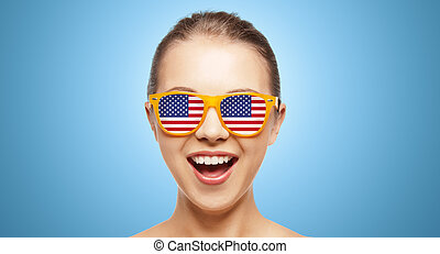 happy teenage girl in shades with american flag - people,...