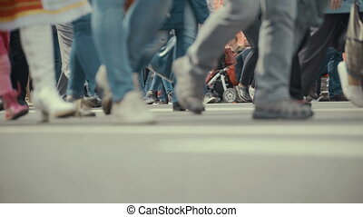 People pedestrians walks across a busy city street. Footage...