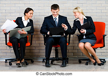 People - Image of business people sitting on the red...
