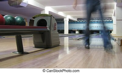 People play bowling in club, time lapse