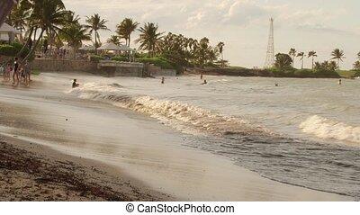 People play in ocean water