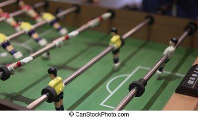 People play table football