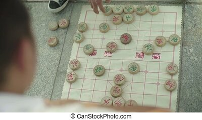 People play the national Chinese game. Beijing. China.