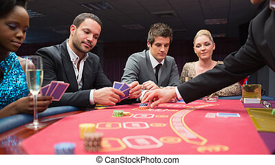 People playing poker at the table
