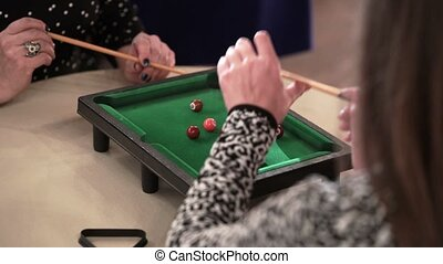 People playing table billiard