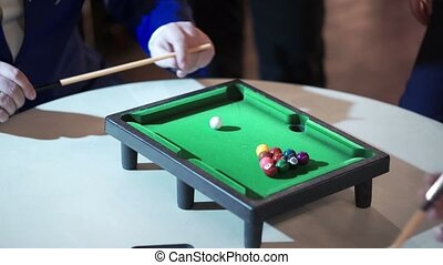 People playing table billiard