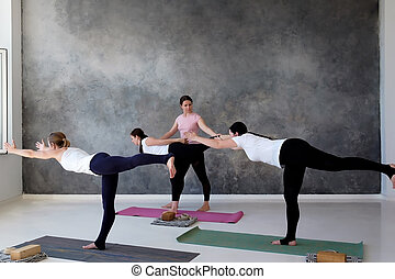 Three People Doing Yoga Poses Yoga Style Young Asian Instructor Holding His Back Straight Crossing Both Legs While Keeping