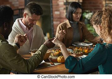 People Praying at Dinner