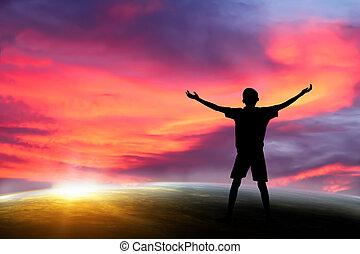 praying - people praying at the sunset. Elements of this...