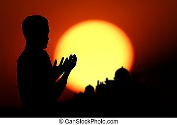 praying - people  praying at the sunset.