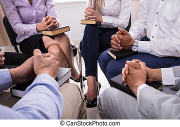 People Praying With Holy Bible