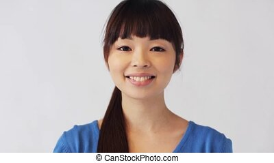 happy smiling asian young woman - people, race, ethnicity...