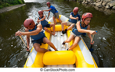 People rafting - A group of friends in an inflatable raft...