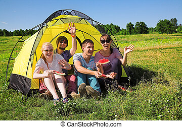 people relaxing in the tent