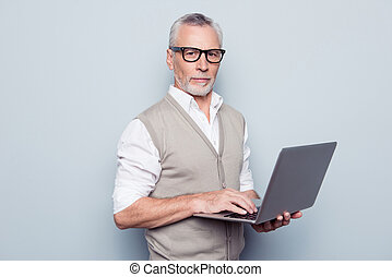 People remote conversation working earning money concept. Half-turned portrait of confident concentrated certain clever qualified experienced restrained agent using netbook isolated on gray background