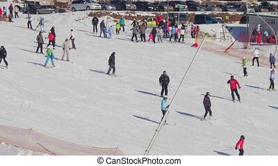 People ride on a ski slope, the view from a distance - View...