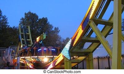 People ride on carousel Disko in park Sokolniki