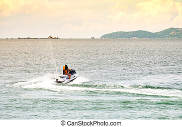 People riding jet ski in the sea