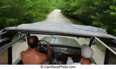 people riding off-road vehicle in forest, video from within...