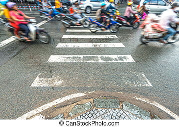 People riding scooters. Traffic in Vietnam. - Street view in...