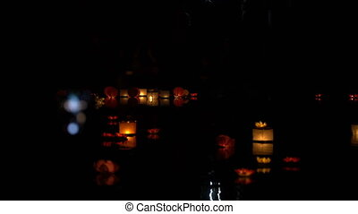 People run water lanterns at night. - People run water...