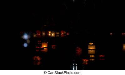 People run water lanterns at night. - People run water...