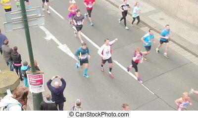 People running at half Marathon eve - PRAGUE, CZECH REPUBLIC...