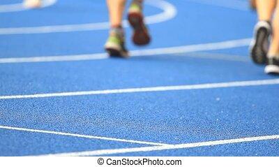 People running on stadium - People running on track stadium