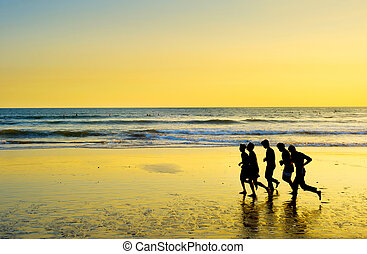 People running on the beach