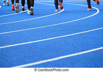 People running on the stadium
