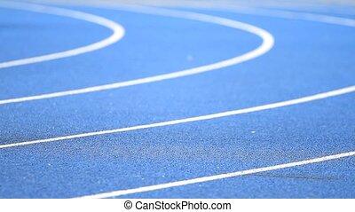 People running on the track stadium