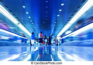 People rush in subway.